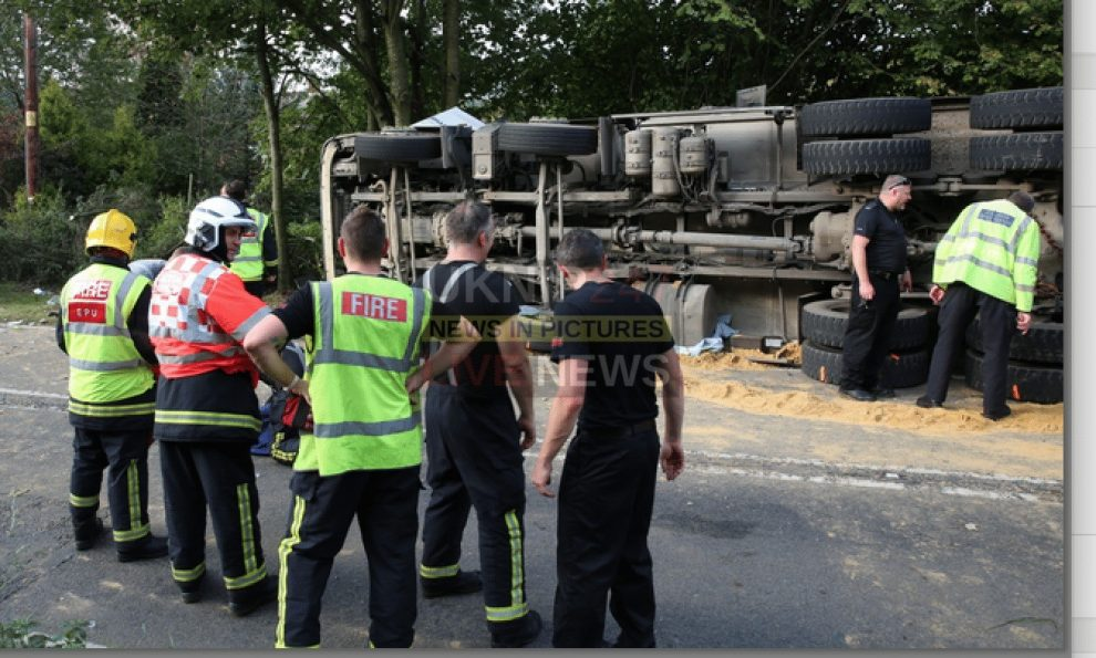 hgv driver freed after being trapped for four hours in overturned lorry