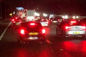 vehicle hitting central reservation closes m25 motorway in surrey