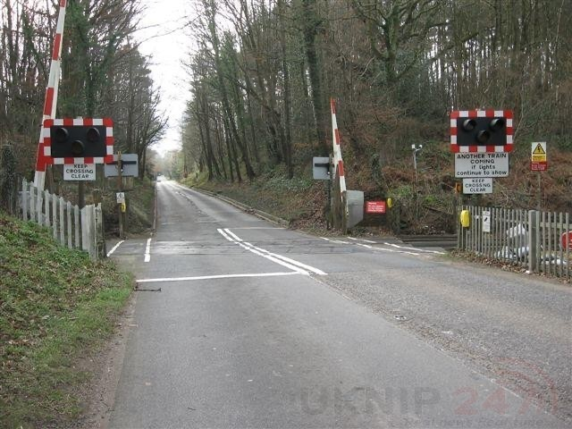 lorry driver ploughs through level crossing