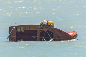 Coastguard and Lifeboat scrabbled to capsized Dingy in Newhaven Port