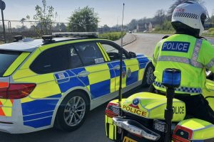 A man has been charged after a stolen car was pursued by police from Worthing to Hove